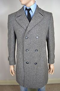 A VINTAGE 1970's VARTEKS INTERNATIONAL PURE NEW WOOL OVERCOAT.    Item Description:        A MEN'S UK LARGE 44 (detailed measurements given below). Grey colour. Six buttons. Double breasted collar and lapel. Button and strap cuffs. Two slit pockets at the waist. Grey lining with two inside pockets. Single vented - buttoned. Made from Pure New Wool. Made by Varteks International. Excellent condition and a truly wonderful winter overcoat. Dry cleaned and steam pressed before being listed.