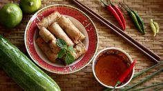 Male hand turn Spring roll plate around, Vietnamese food, vintage style Food concept footage