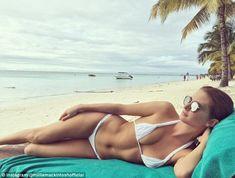 Millie Mackintosh flaunts her abs in skimpy white bikini in Mauritius