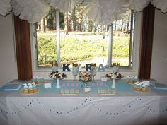 "Homemakin and Decoratin: ""Rain Shower"" Baby Shower. I like the colors and way the table is decoratef"