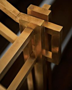 A bronze handrail designed by Michael Landrum and fabricated by Urban Craft. / Paper City Mag