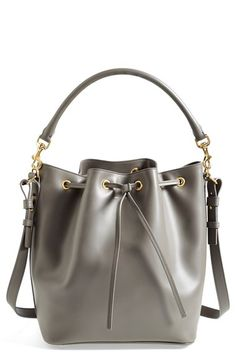 Free shipping and returns on Saint Laurent 'Emmanuelle' Leather Bucket Bag at Nordstrom.com. A departure from Saint Laurent's typical structured silhouettes, this relaxed bucket bag remains true to the Parisian label's refined aesthetic. Wear it crossbody with casual outfits, or use the optional rolled top handle to complement tailored looks.