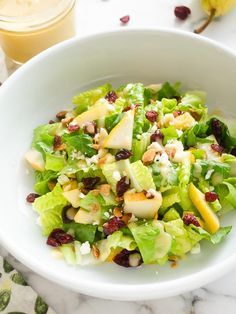Cranberry Pear Salad with Fresh Pear Vinaigrette is crisp romaine tossed with pear, cranberries, feta cheese, and toasted almonds. It's one addicting combination!