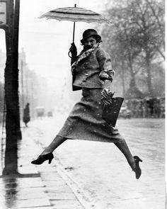Martin Munkacsi - Jumping a puddle, Harper's Bazaar April 1934