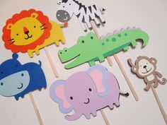 Set of 12 Safari Animals Cupcake Toppers- Zoo Themed Party, Zoo Babies, Zoo Baby Showers, Kids Birthdays. $9.50, via Etsy.