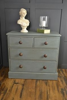 This antique pine chest of drawers has been painted in a mix of Annie Sloan Abbusson Blue & Coco, creating a sophisticated blue/grey colour. Paris Grey has been used Inside the drawers, with the handles being left in their original dark wood, enhancing th