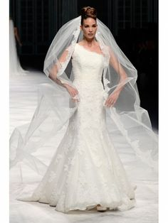 'La Sposa' by the Pronovias Fashion Group     Beautiful dress is you can see through the monster veil!