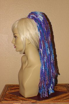 This is a 23' long hair fall, it is a blue, aqua, purple, violet and light blue color fade this fall creates a full and fluffy ponytail or a bun you can wear any time to add some fun to your day.