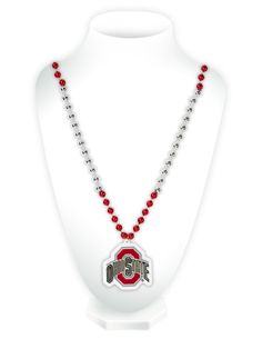 Celebrate your favorite team with this classic Mardi Gras style beaded necklace! It features beads in two team colors and a heavy duty team logo shaped medallion. The medallion is approximately in size, and the necklace is in length. Ohio State Schedule, Football Bracelet, Logo Shapes, Mardi Gras Beads, Beaded Necklace, Pendant Necklace, Ohio State Buckeyes, Diamond, Jewelry