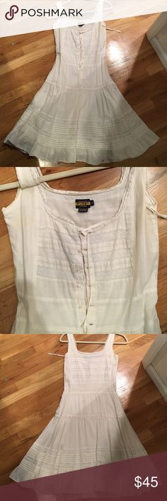 Ralph Lauren Rugby white lace sundress White cotton and lace; fitted at busts and can be adjusted with a string; buttons up the front, flows out at the waist; hangs just below the knee; built in slip Ralph Lauren Dresses