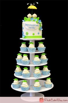 Sarah's Peapod Baby Shower Cupcake Tower by Pink Cake Box in Denville, NJ.  More photos and videos at http://blog.pinkcakebox.com/sarahs-peapod-baby-shower-cupcake-tower-2012-04-29.htm