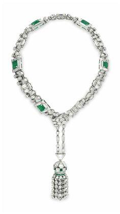 Art Deco emerald and diamond bracelet with a fabulous diamond tassel. Circa 1925.