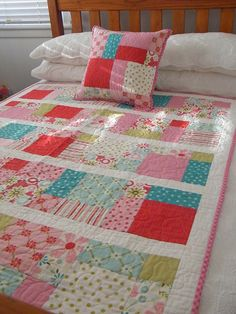 Nice easy quilt. Looks like a disappearing 9-patch with sashing. Good way to stretch a charm pack when you don't quite have enough.