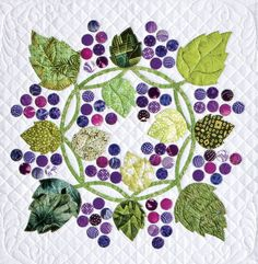 """Free pattern! """"Grape Escape"""" block by Alex Anderson. Pattern download by AQS at Quilt Views as of November 2012. The appliqué motifs are given full size."""