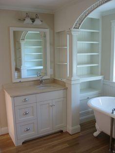 Three drawer/2 butt door vanity with false panel above and decorative toekick