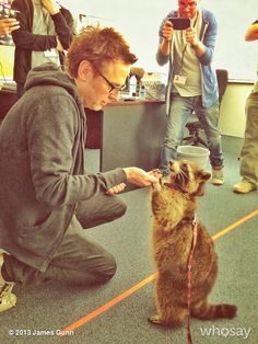 James Gunn w/ raccoon on the set of Guardians of the Galaxy.