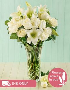 White roses and lilies in RCR opera crystal vase