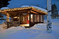Rustic cabin in the mountains at Christmas