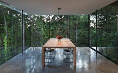 sleek-slope-house-with-interior-featuring-concrete-9-dining-room-straight.jpg