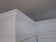 Extended moulding on the kitchen top cabinents     KrisKraft: Painting the Cabinets