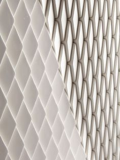 Wellington Tile  A new ceramic tile available in an extensive array of finishes including matt, gloss, metallic and pearlescent.  This diamond tile is laid facing in one of two directions, to enable large scale imagery to be shown to the clients specifications. - Giles Miller Studio