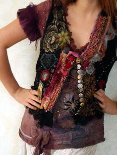 Lifelong Hippie,  romantic embroidered vintage leather vest, wearable art. $283.00, via Etsy.