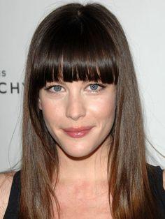 Liv Tyler blunt, full, straight-across bangs: http://beautyeditor.ca/2014/05/30/best-bangs-for-long-face/