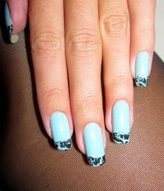 Pale turquoise with black crackle effect tips.