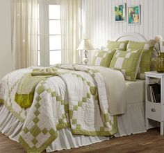 The green Irish Chain design is on a creme background and displays a fashionable, #coastal look.  https://www.uptowncasual.com/products/tierney-luxury-king-quilt #uptownquiltedbedding #kingquilt
