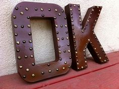 I made my own letter after seeing this, easiest and coolest piece I've made. I sprayed mine black so it looks like leather and used square silver upholstery tacks! Paper Mache Letters, Diy Letters, Letter A Crafts, The Chic Site, Leather Tutorial, Craft Projects, Projects To Try, Light Up Letters, Upholstery Tacks