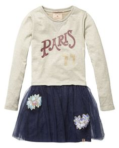Get the Parisian look and team this tulle skirt sweater dress featuring embellishments with golden leggings and an embroidered jacket.