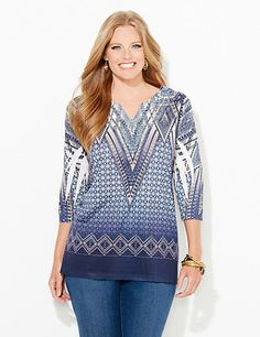 Our beautiful top is covered in a variety of dazzling prints. A crochet inset rests at the neckline with scattered rhinestones for an embellished look. V-neckline. Three-quarter sleeves. Catherines tops are perfectly proportioned for the plus size woman. catherines.com