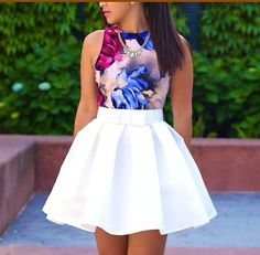 Love the high waisted pleaded skirt with floral sleeveless crop top