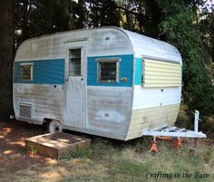 Crafting in the Rain: Camper Trailer Turned Home Office.  There's a trailer just like this down the road from us - we'd love to re-do it!