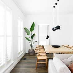 How stunning! A modern, light and fresh dining area! Use lots of whites, timbers, fresh greenery and lots of natural light to recreate this look!