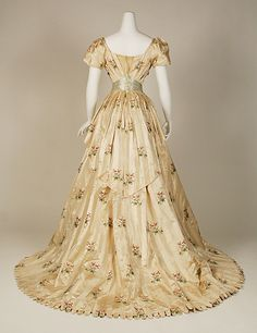 Dress, Evening.  House of Worth (French, 1858–1956).  Date: 1905–8. Culture: French. Medium: silk, metallic thread. Dimensions: Length (a; from shoulder): 18 1/2 in. (47 cm). Length at CF (b): 40 in. (101.6 cm).