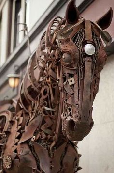 Metal Horse Sculpture on street, downtown  Calgary, Canada; right off Stephens Ave. & close to the Calgary Tower.