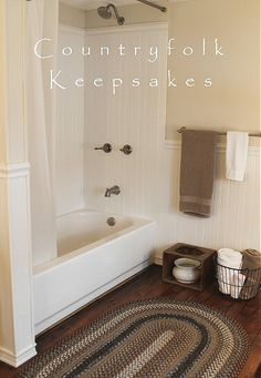 We used vinyl beadboard/wainscoting planks for our  tub surround. <3