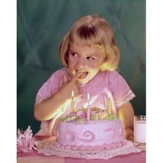 Close-up of a girl licking the icing of a birthday cake Canvas Art - (18 x 24)