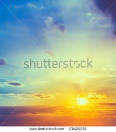 Sun, sunset, sunrise. Colorful toned instant photo by Grisha Bruev, via Shutterstock