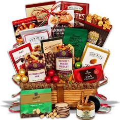 Christmas Gift Basket Premium #gifbasket #gift #xmass #xmas  Gourmet holiday snacks include our signature Macadamia Nut Crunch Popcorn, chocolate chip cookies, dipping pretzels, raspberry honey mustard pretzel dip, gourmet roasted peanuts, a dark chocolate bar, buttered peanut crunch, metropolitan trail mix, dark chocolate raspberry sticks, mint chocolate dipped sugar cookies  potato sticks, 5 O'Clock Crunch, chocolate wafer rolls, our signature Nature's Mixed Medley, and double dipped...