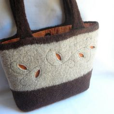 Felted purse, cut- outs!   could use a leather flap closure and staps in black leather, classey