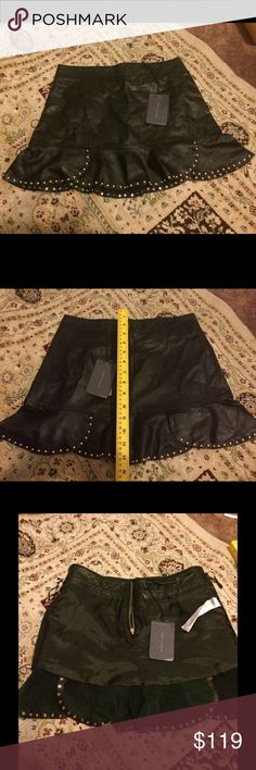Black 100% Leather Studded Skirt  XS Gold Studs Picture 2 shows the back of the skirt. Please note that on the right side the studs do not continue all the way. There are no holes indicating that there were studs to begin with. This is not a flaw. Zara Women Studio Skirts Mini