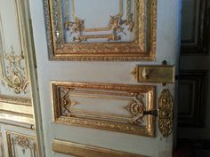A gilded door in the palace of Versailles