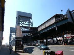 Looking southwest at Broadway Bridge (Manhattan) and 225th Street IRT station on a sunny midday