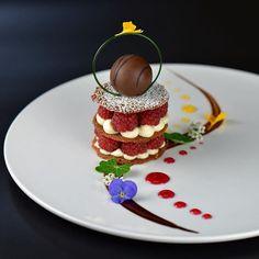 Raspberry-pistachio tulie Napoleon, creme brûlée truffle, white chocolate mousse, citrus & berry sauce, chocolate glaze. ✅ By a…