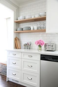 pretty kitchen. wood with subway tile and white cabinets always looks good