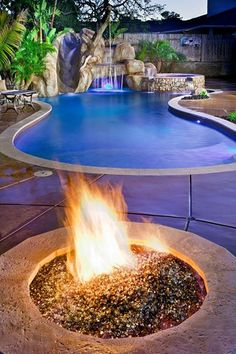 Is this pool and firepit an addition you'd like to have in your backyard?   That slide sure looks fun!