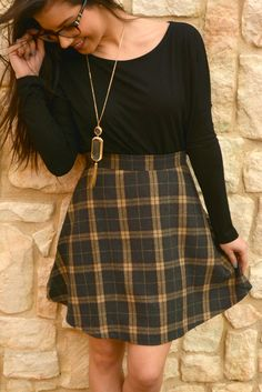 Our True To You Skirt features a brown plaid A-line skirt. Made of 100% Polyester. Model is a size 2 and is wearing a size small. Sizing Notes... Small - 0/2 Medium - 4/6 Large - 8/10
