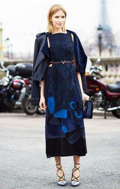 Elena Perminova in a velvet midi dress, moto jacket, and strappy heels
